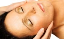 Woman lying, gets massage, reiki,