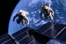 Astronauts in space around the solar battarei.
